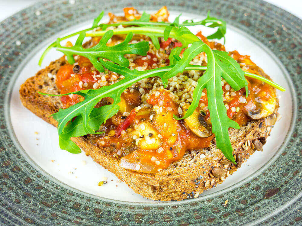 toasted Italian sandwich with tomato and mushroom topping