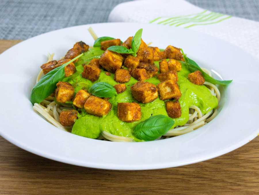 Pasta with green avocado basil pesto and crispy tofu