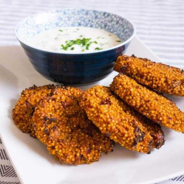 Gluten-free savoury millet patties with sour cream gherkin dip