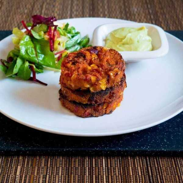 Mexican style sweet potato bean patties with avocado mayonnaise and a crunchy apple salad