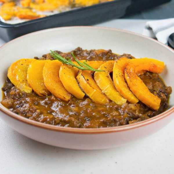 Rosemary roasted butternut squash in a lentil tomato and mushroom sauce
