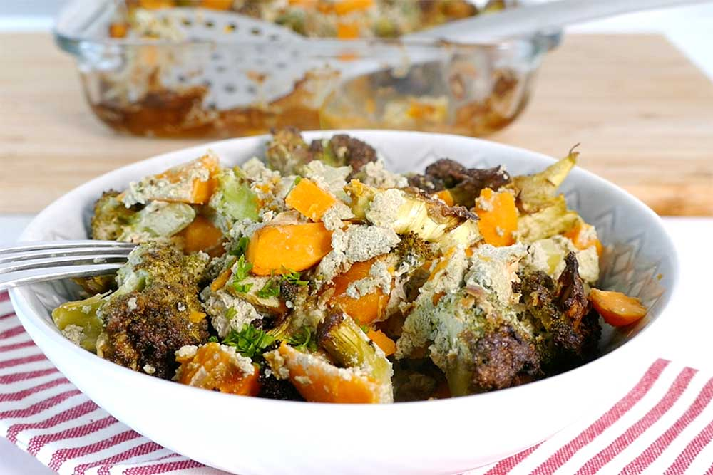 Sweet potato and broccoli bake with pumpkin seed pesto