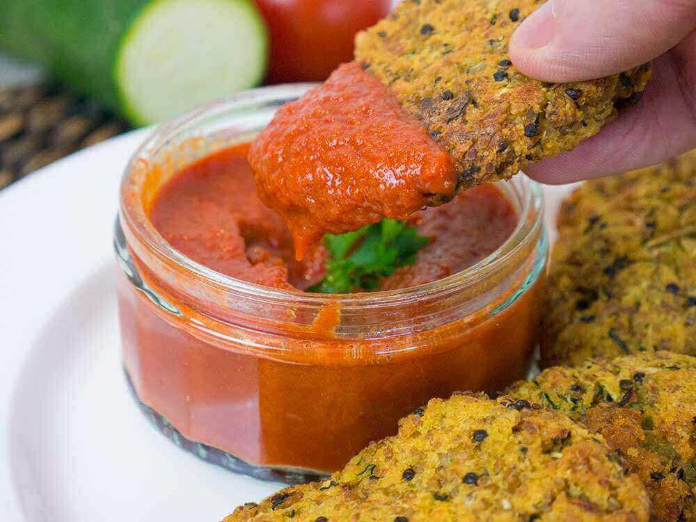 quinoa zucchini patties with smokey red pepper dip