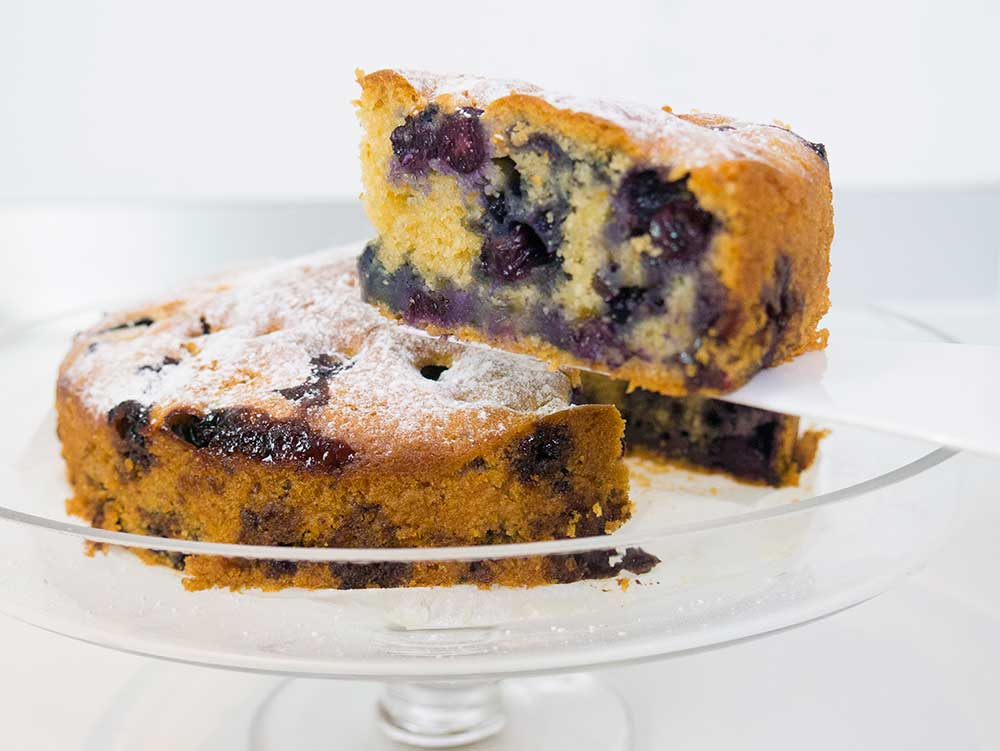 Cutting slice of blueberry cake