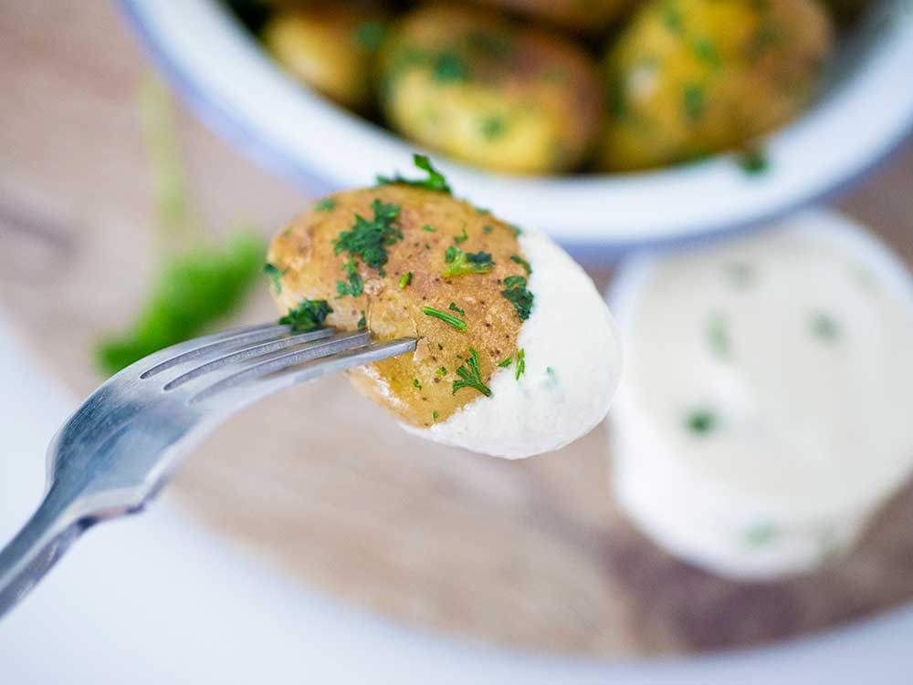 parsley potatoes dunk into vegan sour cream