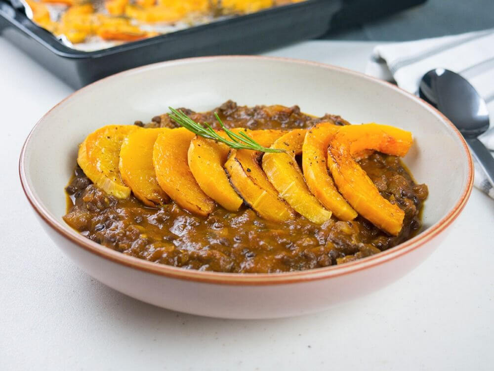 roasted butternut squash in a lentil tomato and mushroom sauce