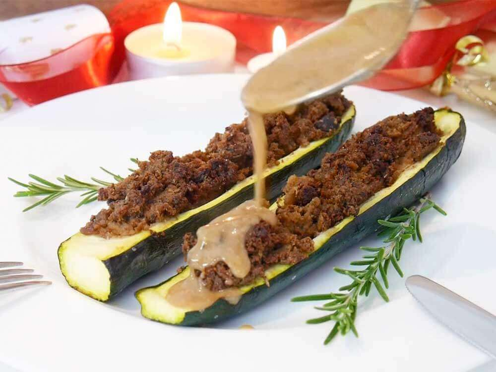Vegan stuffed zucchini with a cranberry pepper sauce