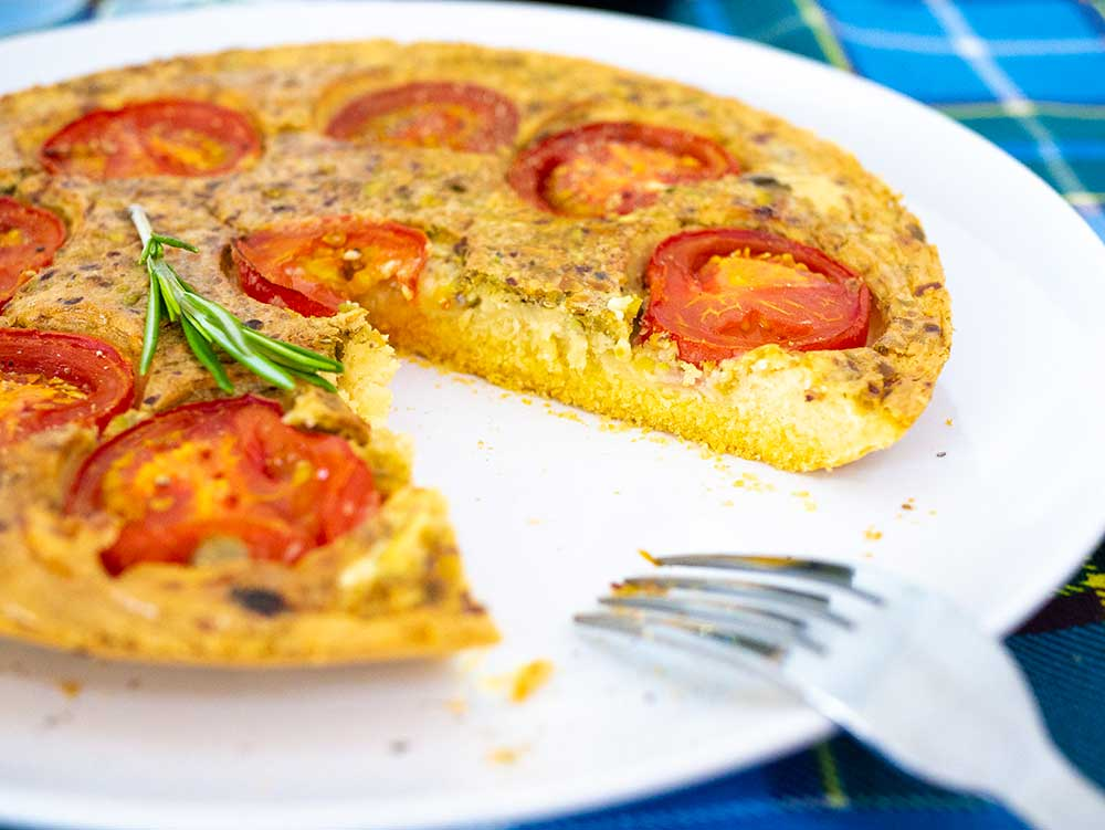 Slice of chickpea polenta quiche