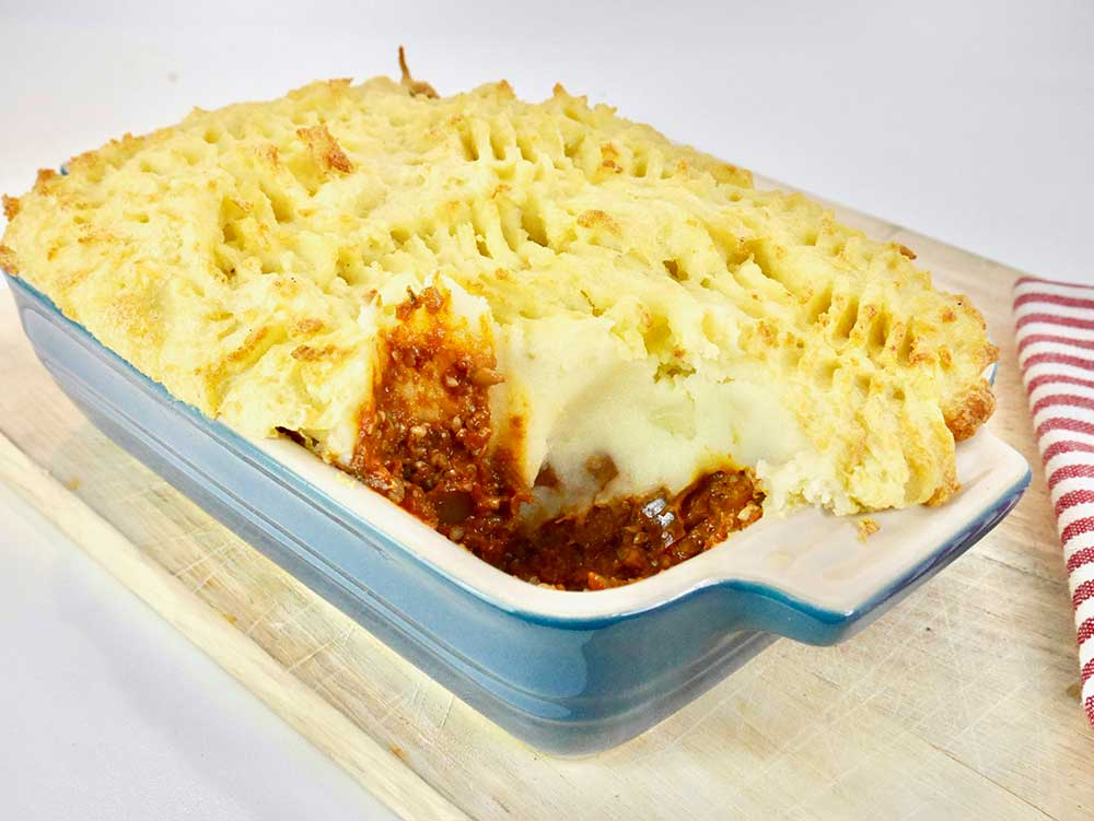 scooping out the vegan cottage pie