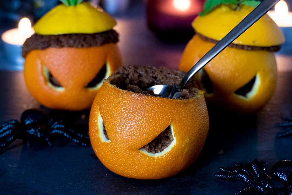Easy vegan Halloween treat in carved out orange
