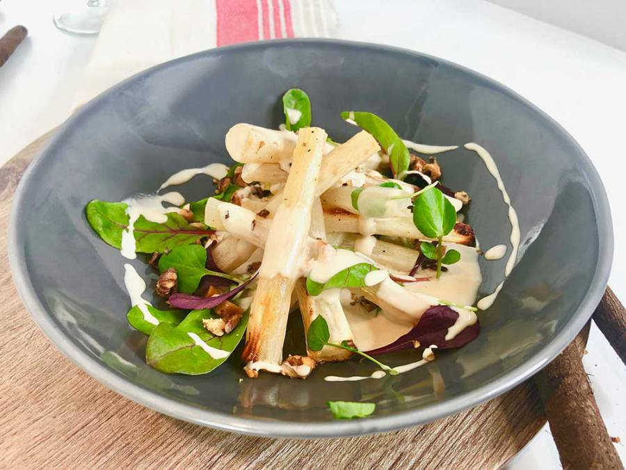 Roasted salsify with toasted walnuts and a lemony tahini dressing