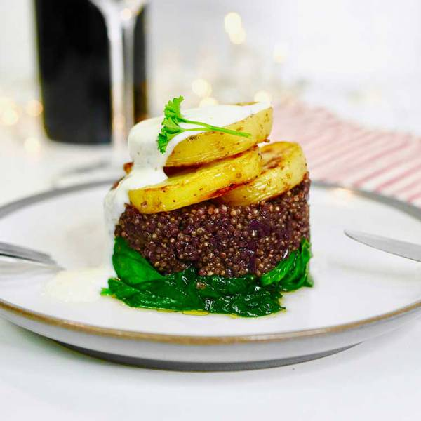 Easy vegan Valentine's day dinner - red wine quinoa on wilted spinach, with potatoes and tahini dressing