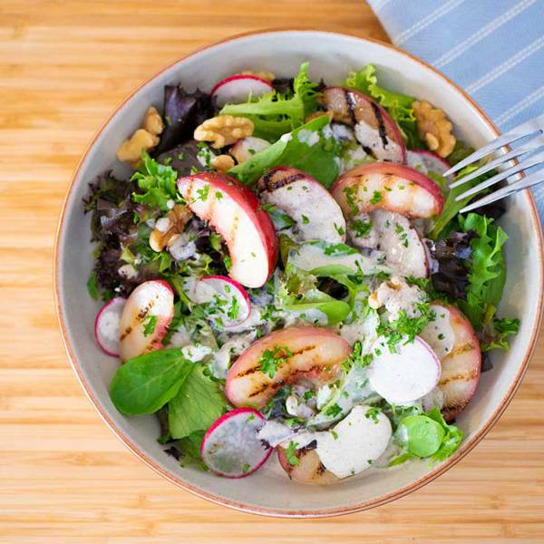 Summer salad with hemp seed dressing and grilled nectarines