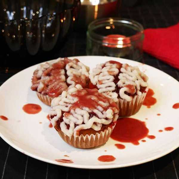 Vegan Halloween cupcakes with custard brains and cherry blood