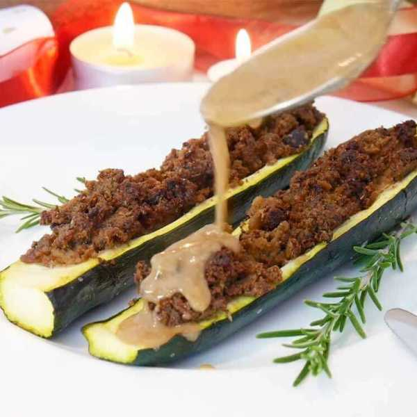 Vegan Christmas recipe - stuffed zucchinis with a cranberry pepper sauce